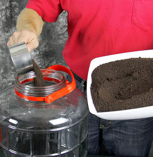 Add coffee grounds to a large jar